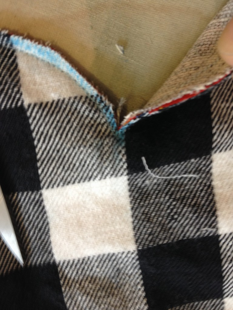 Snip straight down to the corner, without cutting the seam